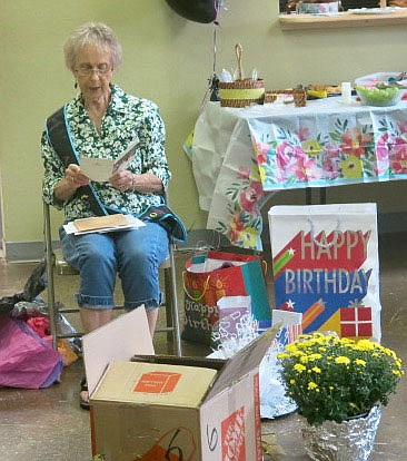 Westside Eagle Observer/SUSAN HOLLAND After opening several gifts from guests at her 80th birthday party, Zanetta Bedwell reads cards from well-wishers at the party. Bedwell's daughter Melanie, other famiy members and friends organized the party which truly was a surprise for her.