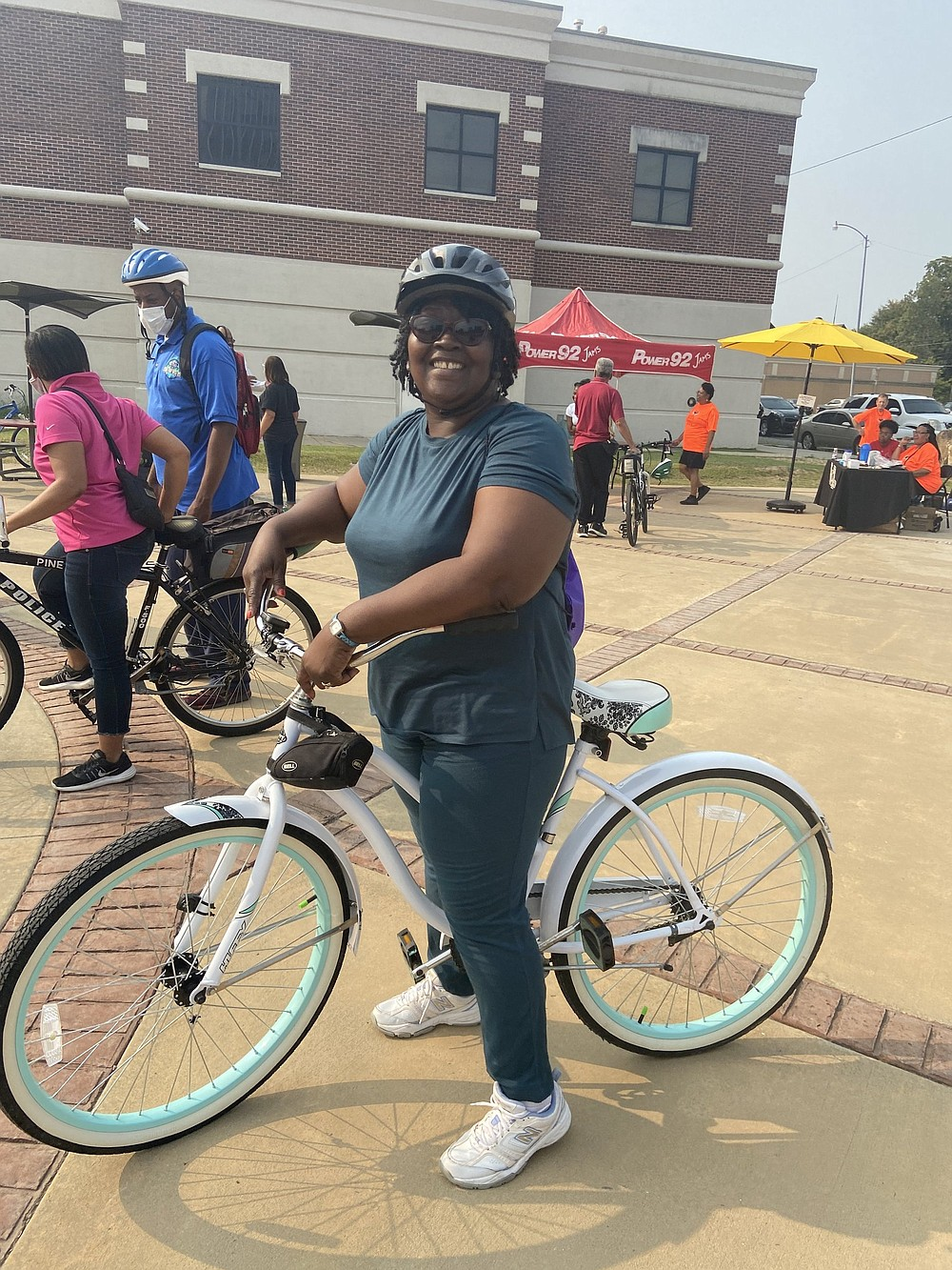 Altheimer Mayor Mayor Zola Hudson gets ready for Saturday morning's Tour de Bluff ride. (Special to The Commercial/Deborah Horn)