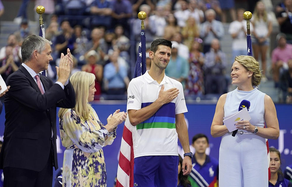 Novak Djokovic, of Serbia, center, reacts while talking to fans after losing to Daniil Medvedev, of Russia, in the men's singles final of the US Open tennis championships, Sunday, Sept. 12, 2021, in New York. (AP Photo/John Minchillo)