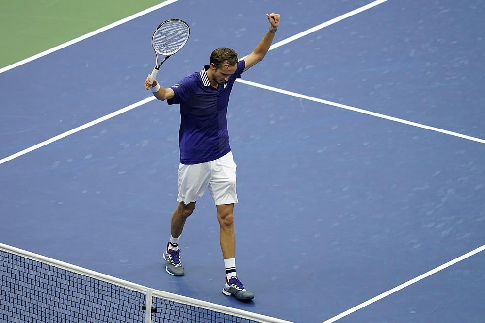 Daniil Medvedev, of Russia, reacts after scoring a point against Novak Djokovic, of Serbia, during the men's singles final of the US Open tennis championships, Sunday, Sept. 12, 2021, in New York. (AP Photo/Seth Wenig)