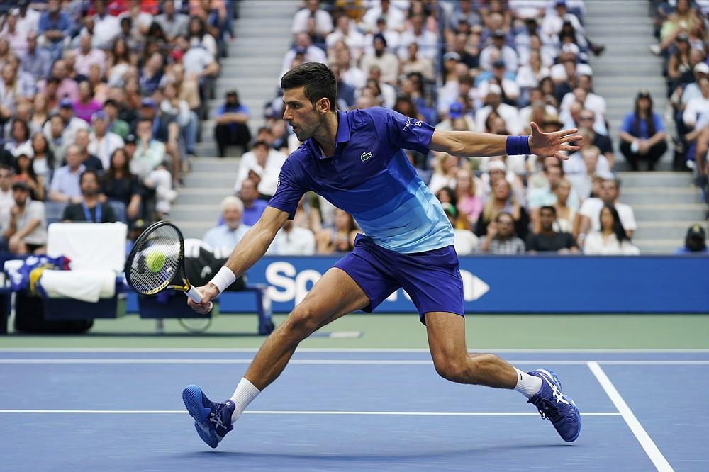 Novak Djokovic, of Serbia, returns a shot to Daniil Medvedev, of Russia, during the men's singles final of the US Open tennis championships, Sunday, Sept. 12, 2021, in New York. (AP Photo/John Minchillo)