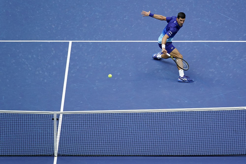 Novak Djokovic, of Serbia, returns a shot to Daniil Medvedev, of Russia, during the men's singles final of the US Open tennis championships, Sunday, Sept. 12, 2021, in New York. (AP Photo/Seth Wenig)