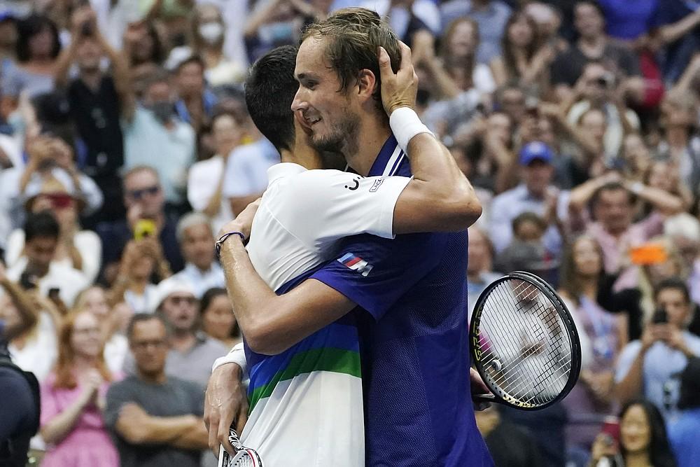 Daniil Medvedev, of Russia, hugs Novak Djokovic, of Serbia, after defeating Djokovic in the men's singles final of the US Open tennis championships, Sunday, Sept. 12, 2021, in New York. (AP Photo/Elise Amendola)
