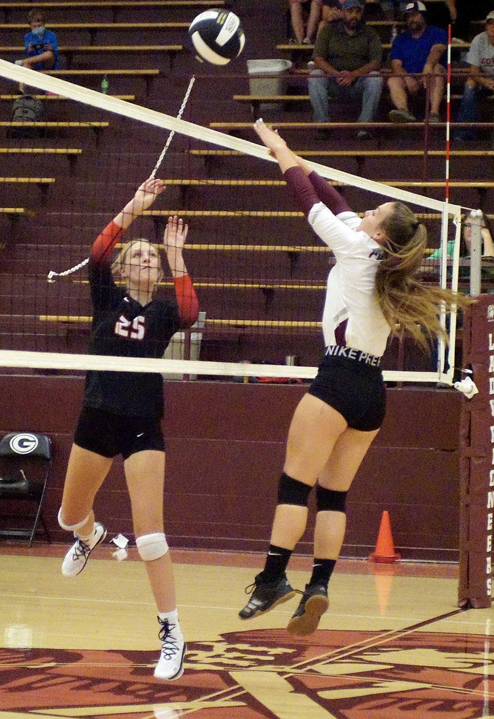 Westside Eagle Observer/RANDY MOLL Gentry junior Madison Voyles goes up to block a Pea Ridge volley during play at Gentry High School on Thursday.