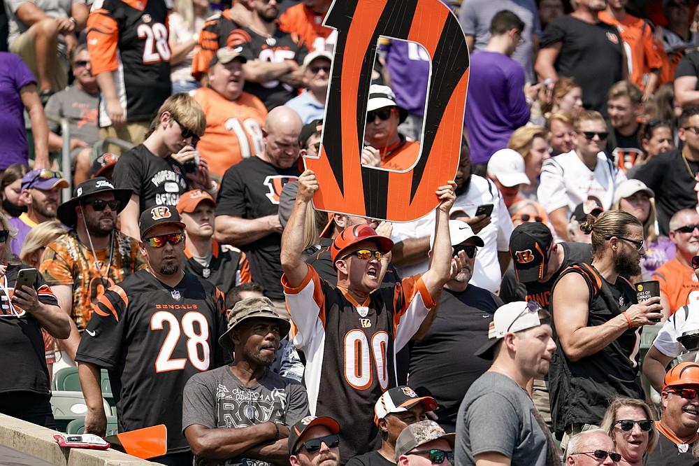 Cincinnati Bengals fans cheer during the first half of an NFL football game against the Minnesota Vikings, Sunday, Sept. 12, 2021, in Cincinnati. (AP Photo/Jeff Dean)