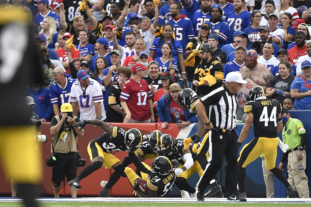 Pittsburgh Steelers linebacker Ulysees Gilbert (54) celebrates with teammates as he lies in the end zone after returning a blocked punt for a touchdown during the second half of an NFL football game against the Buffalo Bills in Orchard Park, N.Y., Sunday, Sept. 12, 2021. (AP Photo/Adrian Kraus)