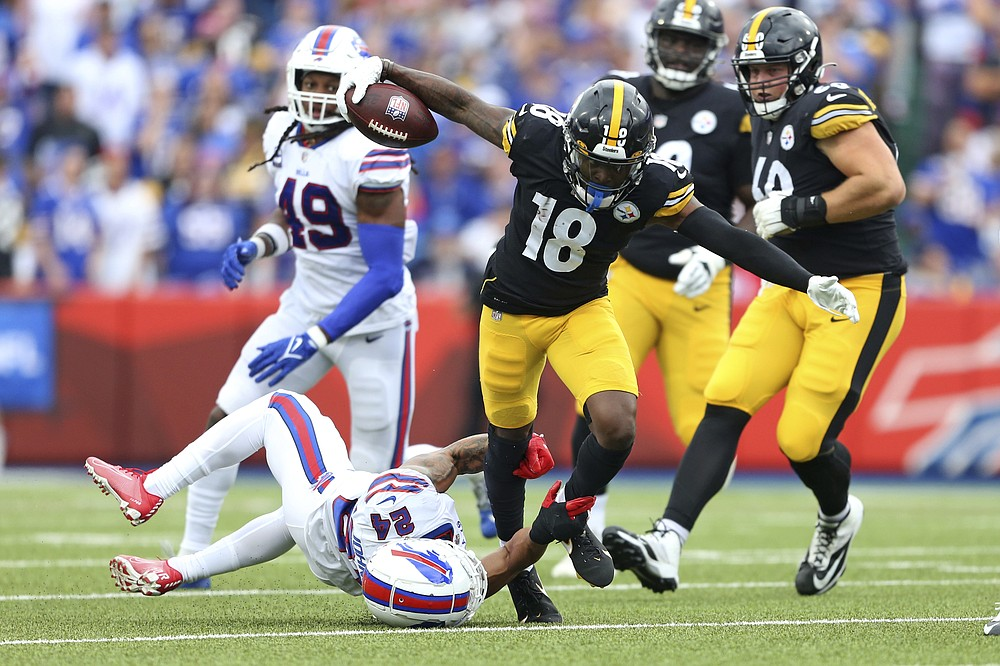 Pittsburgh Steelers wide receiver Diontae Johnson (18) is tackled by Buffalo Bills cornerback Taron Johnson (24) during the second half of an NFL football game in Orchard Park, N.Y., Sunday, Sept. 12, 2021. (AP Photo/Joshua Bessex)