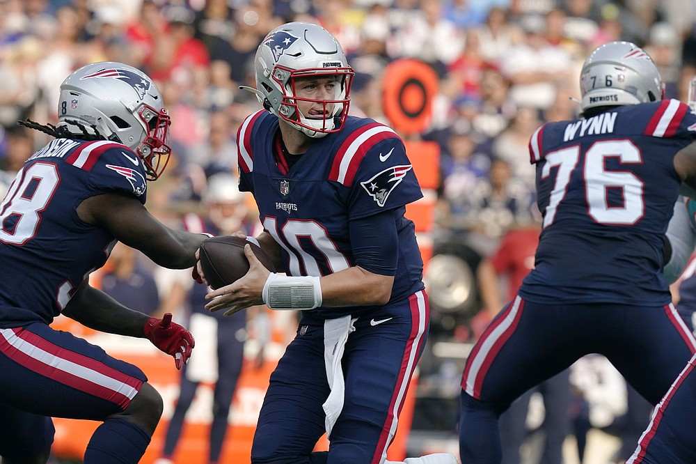 New England Patriots quarterback Mac Jones (10) looks to pass after faking a hand off during the first half of an NFL football game against the Miami Dolphins, Sunday, Sept. 12, 2021, in Foxborough, Mass. (AP Photo/Steven Senne)
