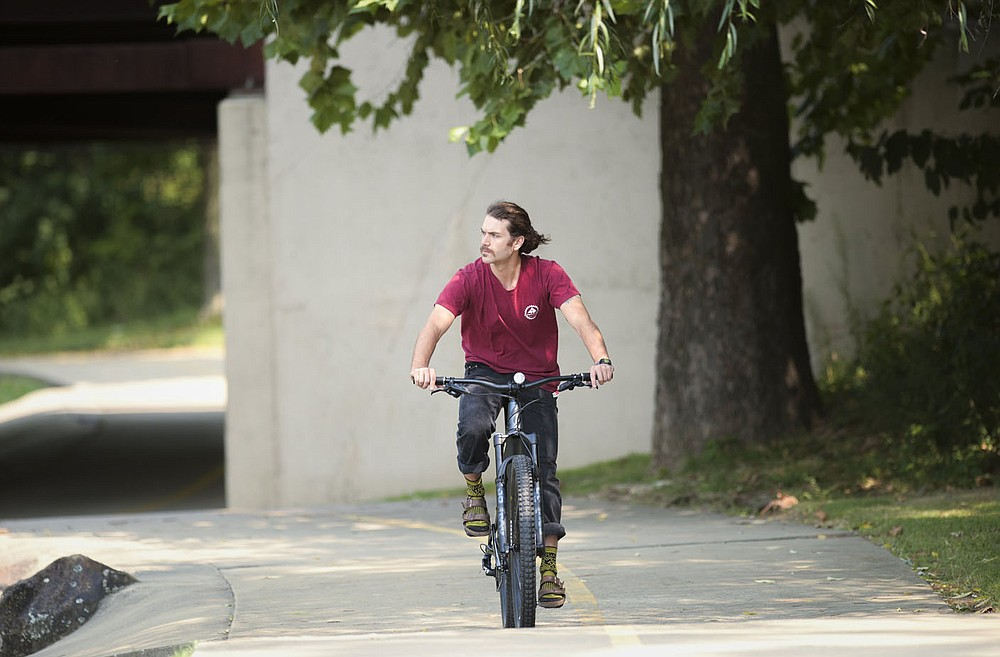 Jake Lee of Fayetteville rides, Friday, September 10, 2021 along the Razorback Greenway in Rogers. Check out nwaonline.com/210912Daily/ for today's photo gallery.  (NWA Democrat-Gazette/Charlie Kaijo)