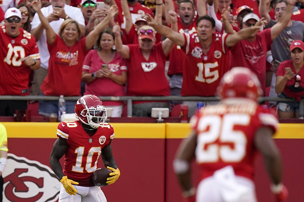 Kansas City Chiefs wide receiver Tyreek Hill (10) celebrates after catching a 75-yard pass for a touchdown during the second half of an NFL football game against the Cleveland Browns Sunday, Sept. 12, 2021, in Kansas City, Mo. (AP Photo/Charlie Riedel)