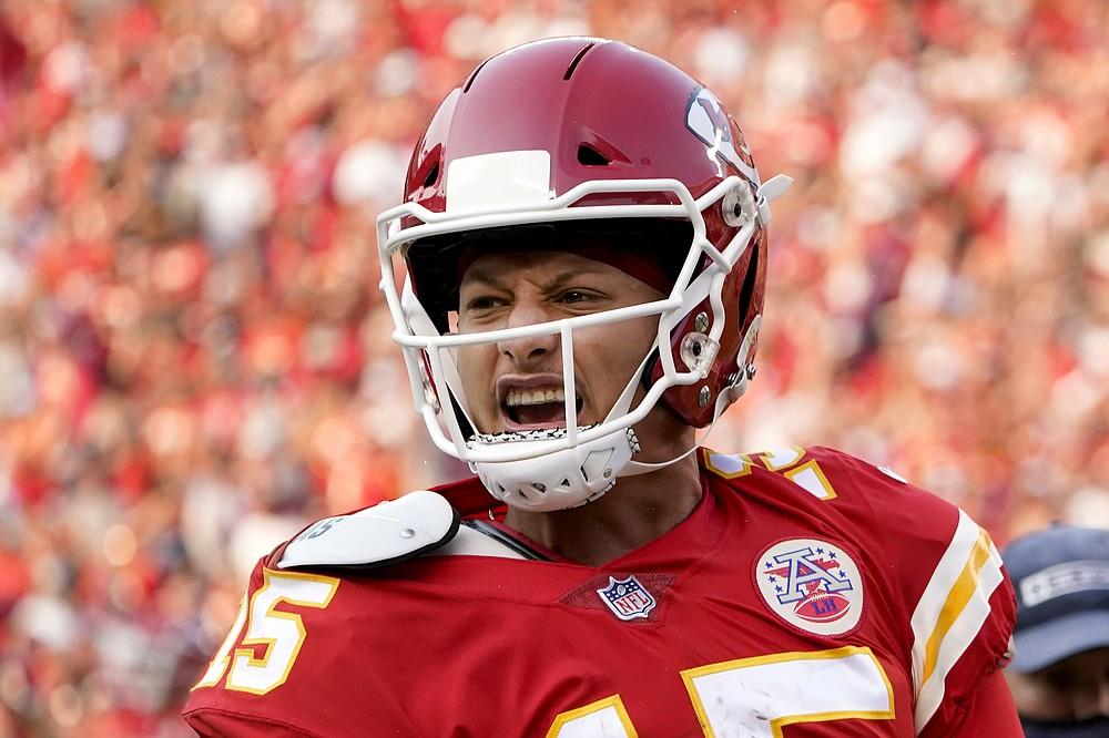 Kansas City Chiefs quarterback Patrick Mahomes celebrates after throwing a touchdown pass during the second half of an NFL football game against the Cleveland Browns Sunday, Sept. 12, 2021, in Kansas City, Mo. (AP Photo/Ed Zurga)