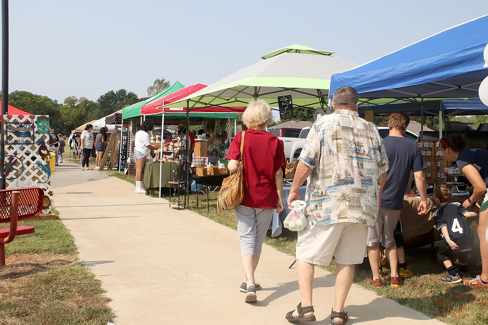 Vendor booths were set up along the walking trail at Creekside Park for the Farmington Fall Festival. The event, which was canceled in 2020 because of covid-19 concerns, included more than 30 vendors, live music, food and a ceremony to commemorate the 20th anniversary of 9-11.