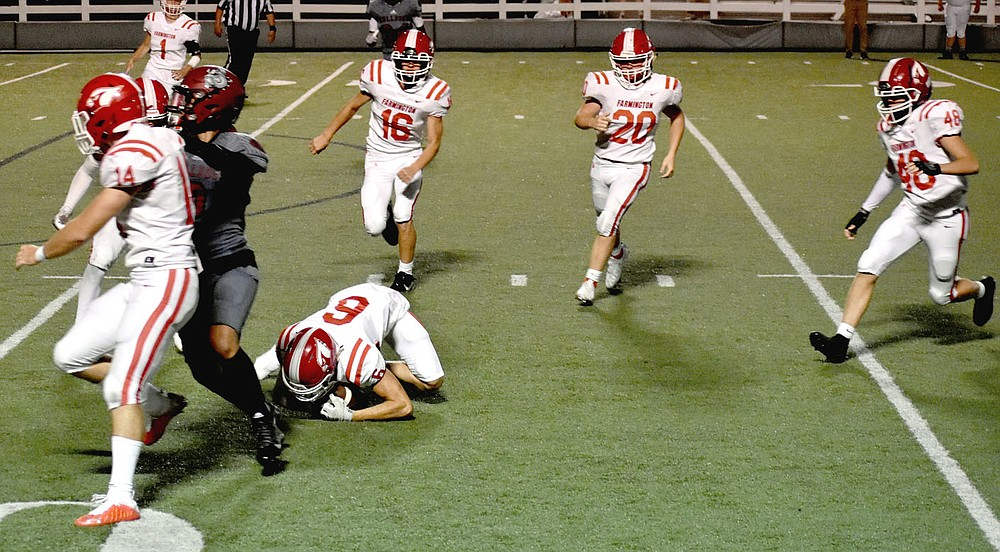 MARK HUMPHREY  ENTERPRISE-LEADER/Farmington senior Kyler Petree (No. 6) recovers a fumble at Springdale's 12-yard line which set up a game-tying touchdown drive and winning extra-point kick Friday at Jarrell Williams Bulldog Stadium. Racing in to help cover are (from left) senior Myles Harvey (No. 14), junior Marcus Clevenger (No. 1), junior Drew White (No. 16), sophomore Cole Cantrell (No. 20) and sophomore Asher Hendrix (No. 48).