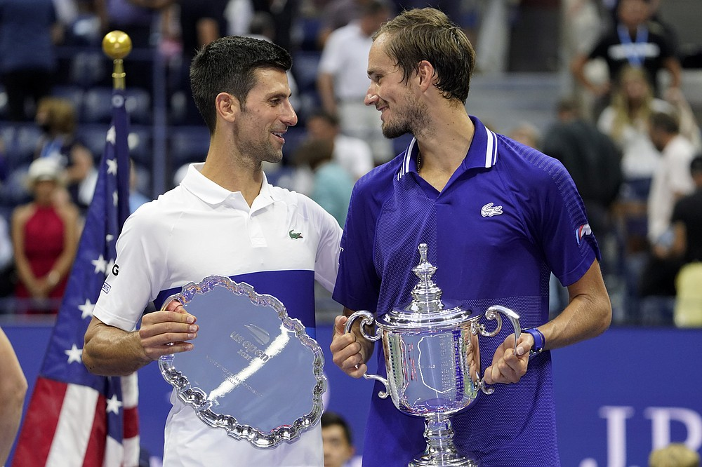 Novak Djokovic, of Serbia, left, and Daniil Medvedev, of Russia, talk during the trophy ceremony after the men's singles final of the US Open tennis championships, Sunday, Sept. 12, 2021, in New York. (AP Photo/John Minchillo)