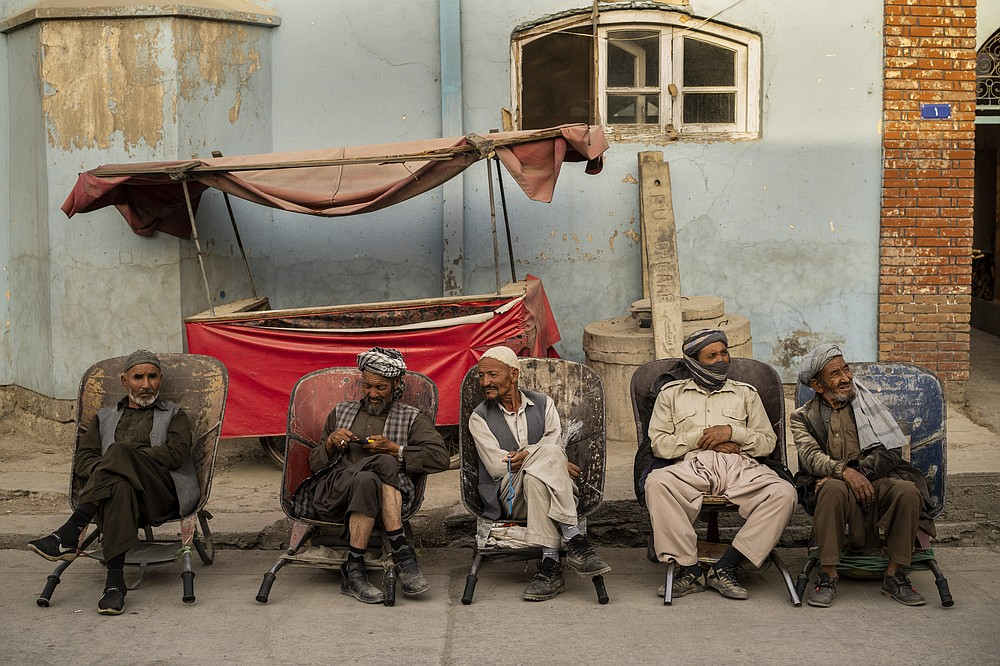Laborers wait in the street to be hired, in Kabul, Afghanistan, Sunday, Sept. 12, 2021. (AP Photo/Bernat Armangue)