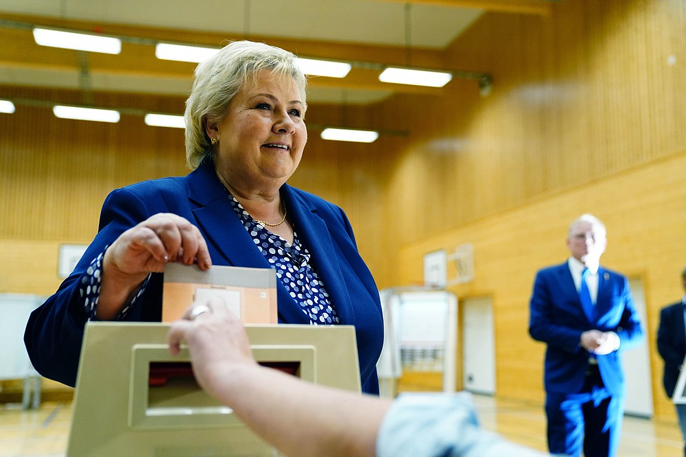 Norway's Prime Minister Erna Solberg, leader of the The Conservative Party Hoyre, casts her ballot in the 2021 parliamentary elections, at Skjold School in Bergen, Norway, Monday, Sept. 13, 2021. Norwegians are heading to the polls on Monday with the ruling Conservatives, led by Prime Minister Erna Solberg, and the opposition Labor Party, which is leading in opinion polls, both advocating for a gradual move away from the use of fossil fuels that continue to underpin the economy. (Hakon Mosvold Larsen/NTB via AP)