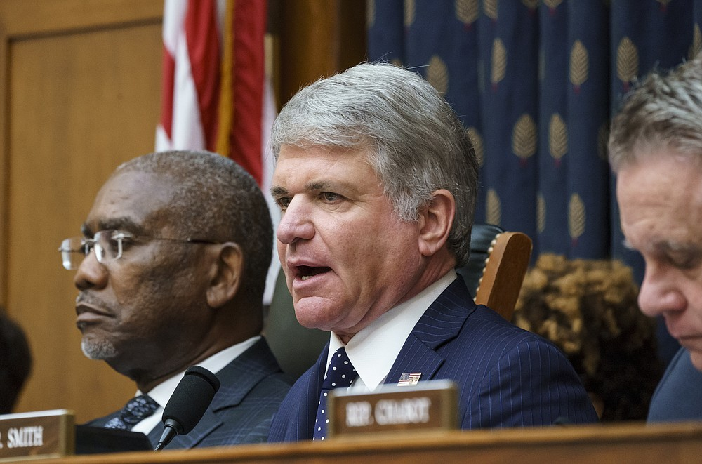 Rep. Michael McCaul, R-Texas, ranking member of the House Foreign Affairs Committee, joined at left by Chairman Gregory Meeks, D-N.Y., discusses the U.S. withdrawal from Afghanistan with Secretary of State Antony Blinken who appeared remotely, at the Capitol in Washington, Monday, Sept. 13, 2021. (AP Photo/J. Scott Applewhite)