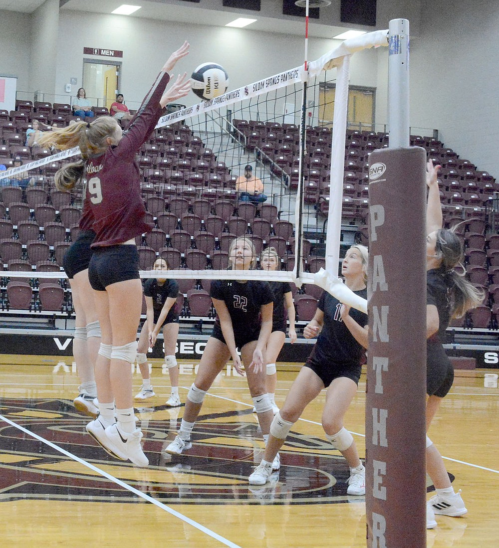 Graham Thomas/Herald-Leader Siloam Springs senior Emma Norberg and sophomore Lillian Wilkie go up to block a ball against Huntsville on Monday at Panther Activity Center.