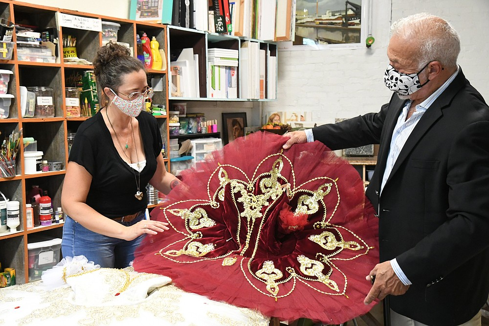 The Sentinel-Record/Tanner Newton /caption: Erin Holliday, left, executive director of Emergent Arts, and Edmond Cooper, artistic director and president of the Hot Springs Dance Theatre Company, look at ballet costumes. HS EmergentBallet-2 090821.JPG attached