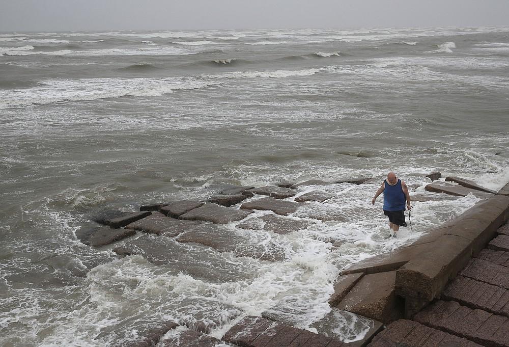 John Pittman, a nurse who works in emergency medicine, fishes to decompress as Tropical Storm Nicholas heads toward the Texas coast, Monday, Sept. 13, 2021, along the seawall in Galveston, Texas. (Jon Shapley/Houston Chronicle via AP)