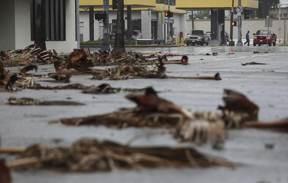 People get gas the morning after Hurricane Nicholas made landfall along the coast, Tuesday, Sept. 14, 2021, in Galveston, Texas. (Jon Shapley/Houston Chronicle via AP)