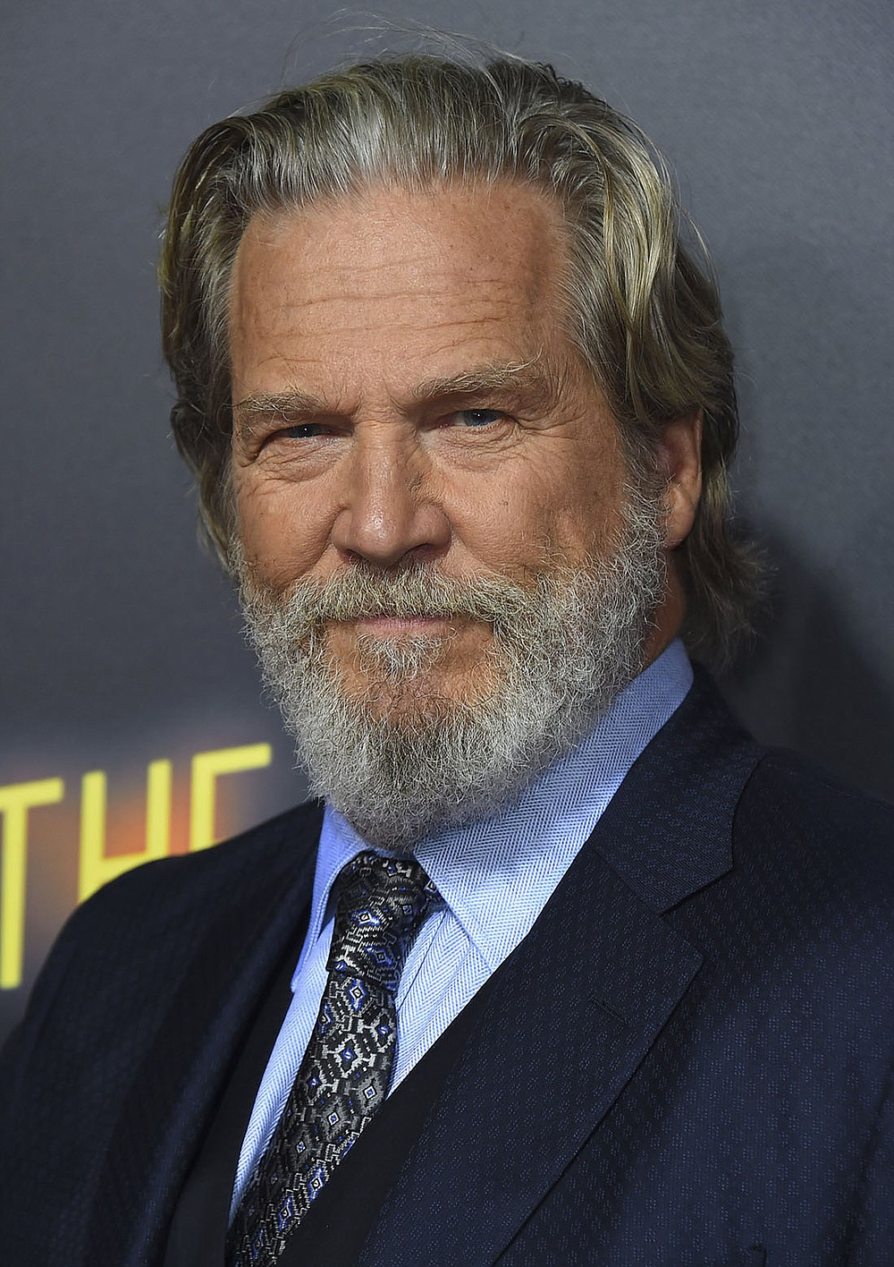 """FILE - In this Sept. 22, 2018 file photo, Jeff Bridges arrives at the Los Angeles premiere of """"Bad Times at the El Royale."""" The Hollywood Foreign Press Association announced Monday that Bridges will be honored with the Cecil B. DeMille Award at the Golden Globe Awards ceremony on Jan. 6, 2019. The actor is known for starring in films including """"Crazy Heart,""""ù """"The Big Lebowski,""""ù """"True Grit""""ù and """"Hell or High Water.""""ù (Photo by Jordan Strauss/Invision/AP, File)"""