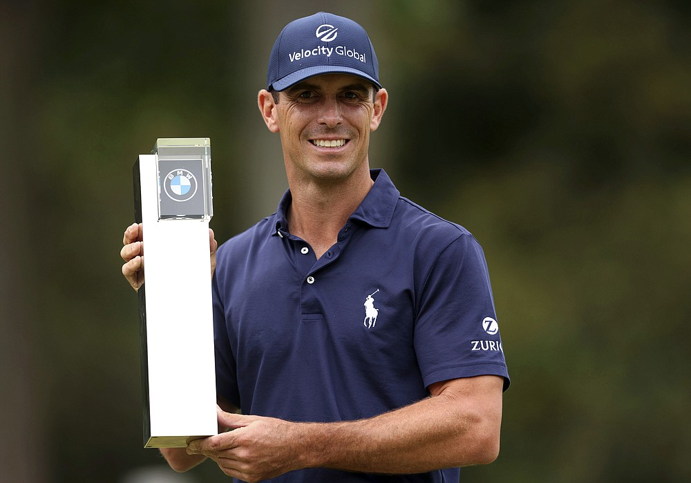 Billy Horschel of the U.S lifts the trophy after victory during day four of the PGA Championship at Wentworth Golf Club, Surrey, England, Sunday, Sept. 12, 2021. (Steven Paston/PA via AP)