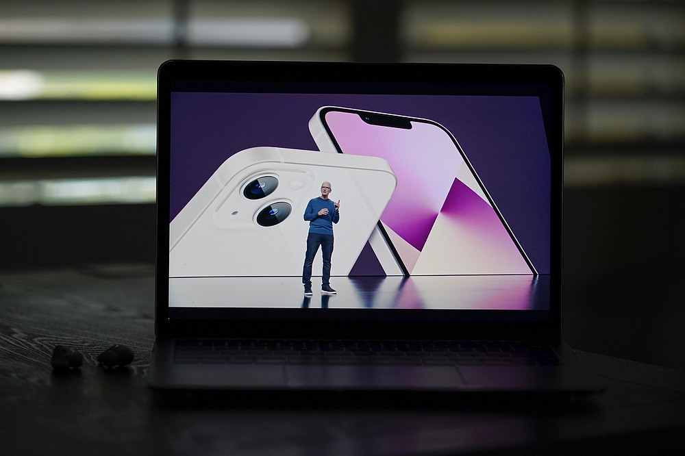 Seen on the screen of a device in La Habra, Calif., Apple CEO Tim Cook introduces the new iPhone 13 smartphones during a virtual event held to announce new Apple products Tuesday, Sept. 14, 2021. (AP Photo/Jae C. Hong)