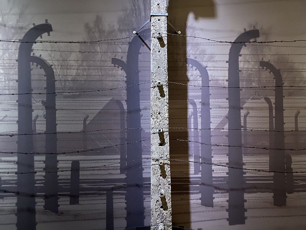 The Germans isolated the Auschwitz camp from the outside world and surrounded it with barbed wire fencing. All contact with the outside world was forbidden. These are original posts from the camp.  (Pawel Sawicki, Auschwitz Memorial)