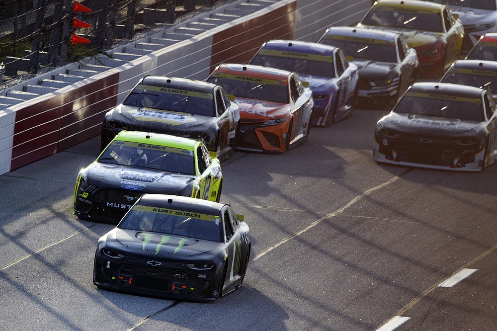 Kurt Busch (1) leads Ryan Blaney (12) after the first yellow flag during a NASCAR Cup Series auto race Sunday, Sept. 5, 2021, in Darlington, S.C. (AP Photo/John Amis)