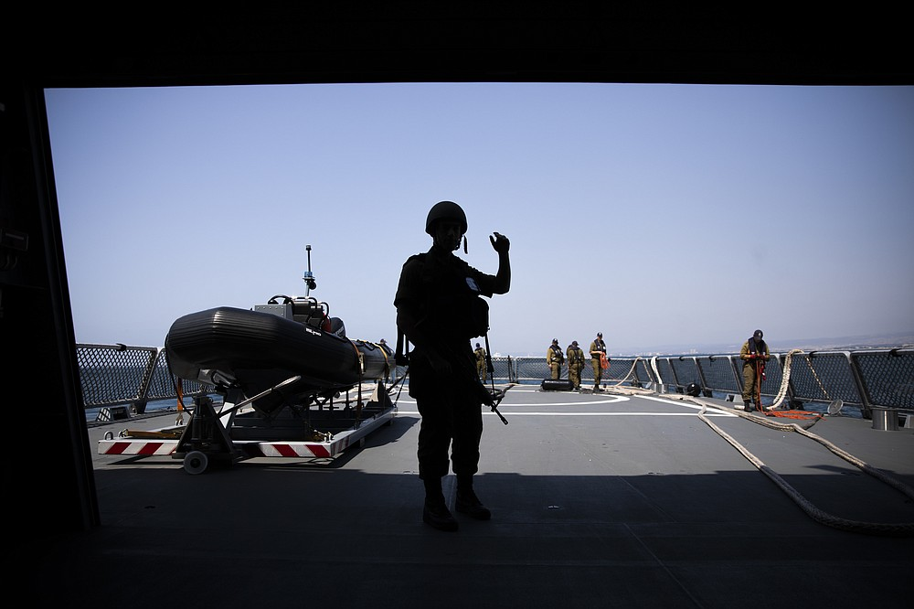 Israeli Navy sailors stand on deck of the Israeli Navy Ship Atzmaut, in the Mediterranean Sea, Wednesday, Sept. 1, 2021. In an interview with the Associated Press, Israel's just-retired navy chief Vice Adm. Eli Sharvit, described Iranian activities on the high seas as a top Israeli concern and said the navy is able to strike wherever necessary to protect the country's economic and security interests. (AP Photo/Ariel Schalit)