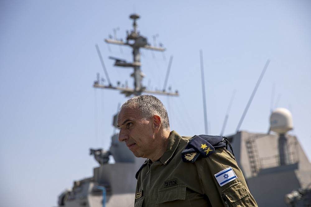 Vice Adm. Eli Sharvit arrives on board the Israeli Navy Ship Atzmaut in the Mediterranean Sea, Wednesday, Sept. 1, 2021. In an interview with the Associated Press, Sharvit, Israel's just-retired navy chief, described Iranian activities on the high seas as a top Israeli concern and said the navy is able to strike wherever necessary to protect the country's economic and security interests. (AP Photo/Ariel Schalit)