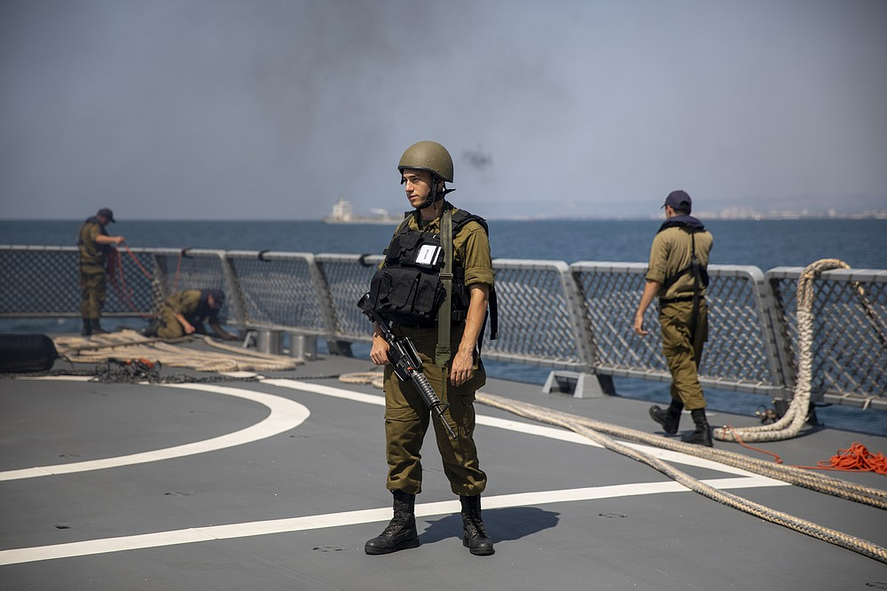 Israeli Navy sailors man the deck of the Israeli Navy Ship Atzmaut, in the Mediterranean Sea , Wednesday, Sept. 1, 2021. In an interview with the Associated Press, Israel's just-retired navy chief Vice Adm. Eli Sharvit, described Iranian activities on the high seas as a top Israeli concern and said the navy is able to strike wherever necessary to protect the country's economic and security interests. (AP Photo/Ariel Schalit)