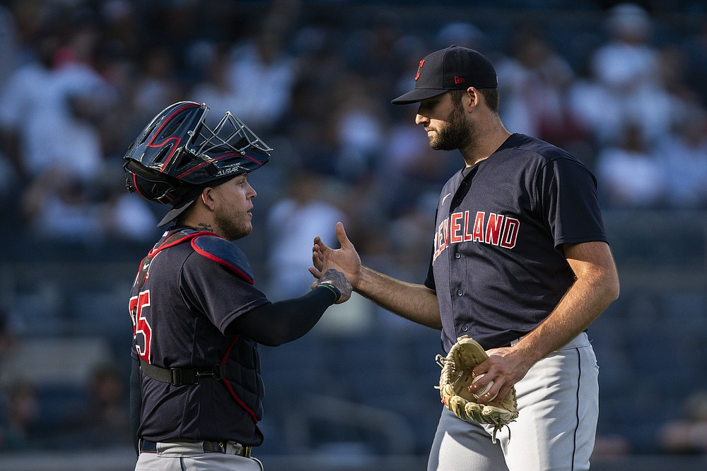 Cleveland Indians relief pitcher Sam Hentges, left, celebrates with catcher Roberto Perez after defeating the New York Yankees in a baseball game Sunday, Sept. 19, 2021, in New York. (AP Photo/Eduardo Munoz Alvarez)