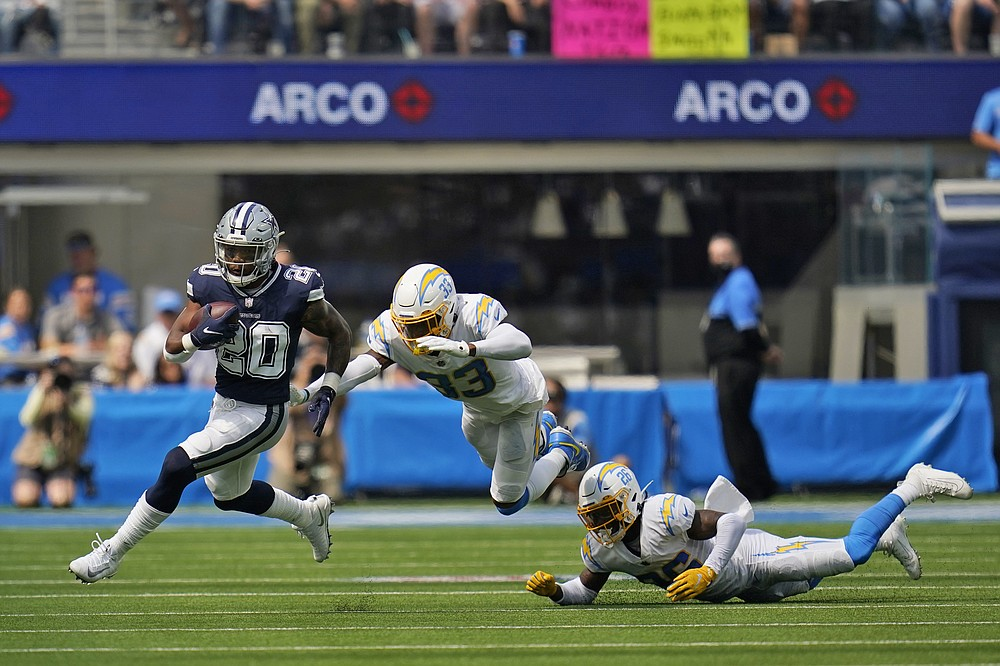 Dallas Cowboys running back Tony Pollard (20) runs past Los Angeles Chargers free safety Derwin James (33) during the first half of an NFL football game Sunday, Sept. 19, 2021, in Inglewood, Calif. (AP Photo/Gregory Bull )