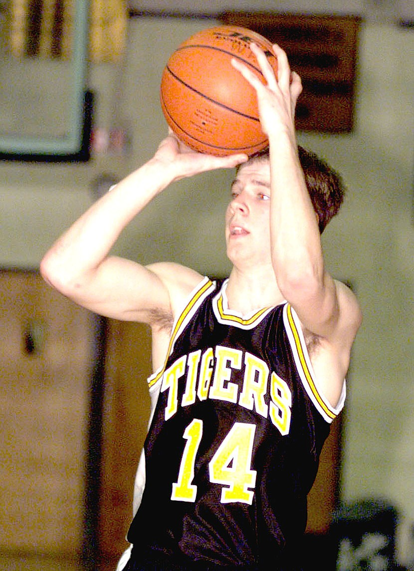 Arkansas Democrat Gazette/BOB COLEMAN/In this historical game photo, Prairie Grove's Dustin Dougan, then a senior in high school, looks to make a pass during a game against West Fork on Tuesday, Jan. 19, 1999. The former Tiger basketball star, whom teammate Patrick Abshier remembers could make shots from anywhere across halfcourt, married his high school sweetheart, Shelley Ledford, now Shelley Dougan. The couple have been married 17 years and raised their two children in the community. Dustin was diagnosed with Maxillary sinus cancer in 2019. In March doctors removed Dustin's left eye because of the cancer and there were complications. He suffered a stroke and continues to fight to regain his health.