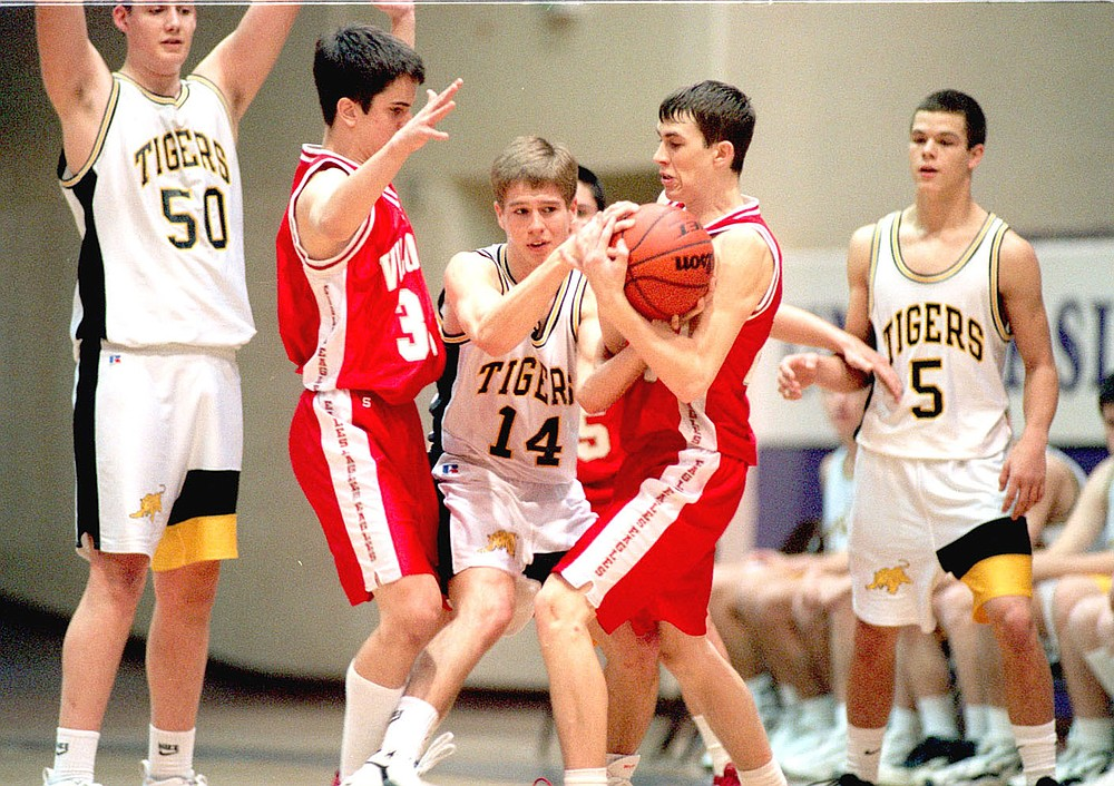 Arkansas Democrat-Gazette/KAREN VANDONGE/Prairie Grove's Dustin Dougan (No. 14) fights for the ball with Vilonia's Nick Weaver (left) and Clint Mears during the second half of their game on the afternoon of Wednesday, Dec. 12, 1998, during the UCA high school tournament. Prairie Grove won and advanced to the semifinals. Dougan's high school teammates, Luke Morris (No. 50), a 6-9 center, and Patrick Abshier (No. 5) are also pictured. The trio of big scorers caused match-up problems for Tiger opponents during their careers.