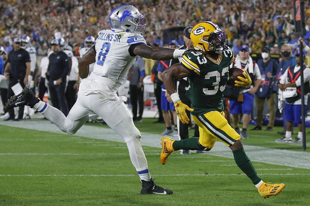 Green Bay Packers' Aaron Jones gets past Detroit Lions' Jamie Collins for a touchdown during the second half of an NFL football game Monday, Sept. 20, 2021, in Green Bay, Wis. (AP Photo/Matt Ludtke)