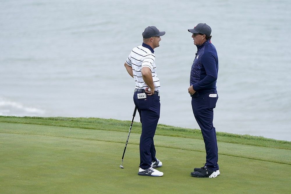 Team USA's Bryson DeChambeau chats with Phil Mickelson on the third hole during a Ryder Cup practice day at the Whistling Straits Golf Course on Tuesday September 21, 2021 in Sheboygan, Wisconsin (AP Photo / Charlie Neibergall)
