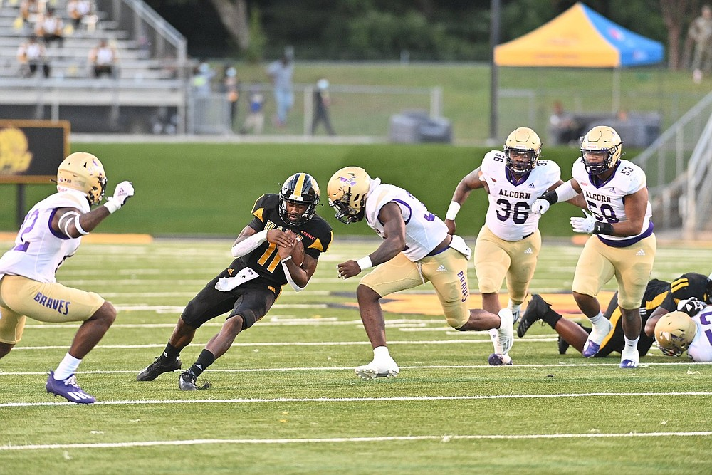 UAPB quarterback Skyler Perry tries to split a tackle by Alcorn State defenders in the first quarter Thursday at Simmons Bank Field. (Special to The Commercial/Darlena Roberts)