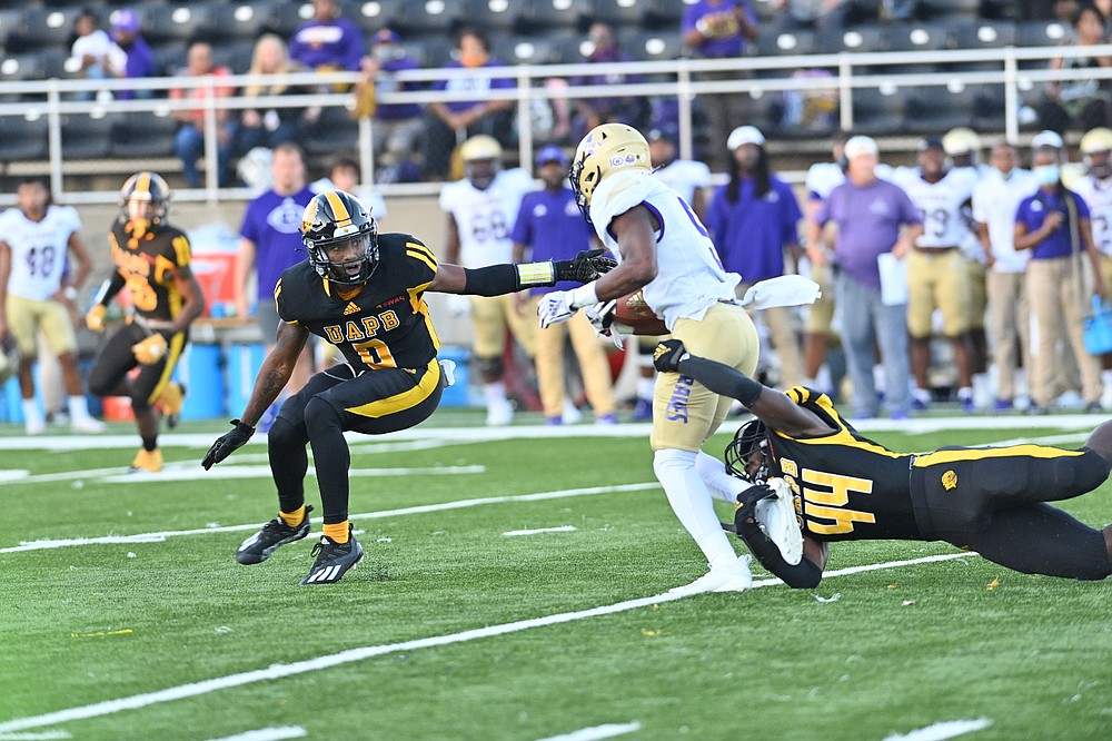 UAPB free safety Jalon Thigpen closes in on a play as linebacker Monroe Beard tackles Alcorn State running back Niko Duffey in the first quarter Thursday. (Special to The Commercial/Darlena Roberts)