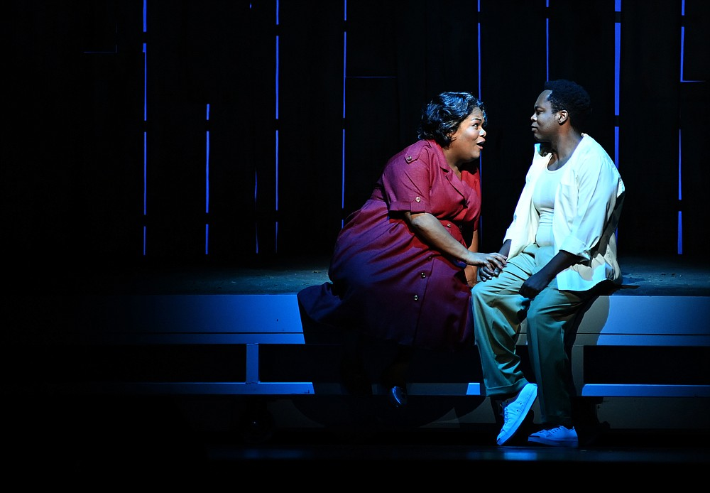 """Actors Latonia Moore and Will Liverman go through a final rehearsal of Terence Blanchard's opera, """"Fire Shut up in My Bones,"""" Sept. 17 at the Metropolitan Opera House. (The Washington Post/Marvin Joseph)"""