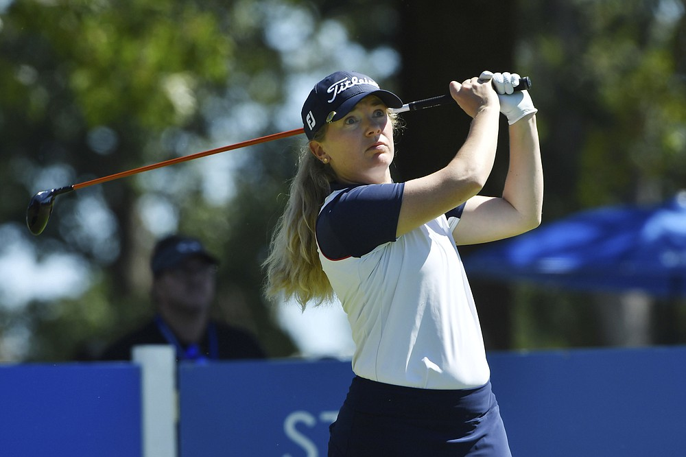 Bronte Law, of England, watches her drive on the 9th tee during the second round of the LPGA Walmart NW Arkansas Championship golf tournament, Saturday, Sept. 25, 2021, in Rogers, Ark. (AP Photo/Michael Woods)