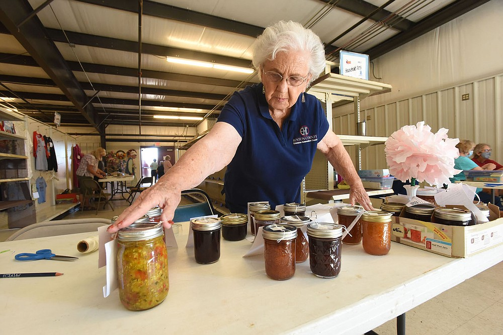 Katie Rieff gets jams, jellies and other treats checked in on Saturday Sept. 25 2021 for judging in the food preservation category. (NWA Democrat-Gazette/Flip Putthoff)
