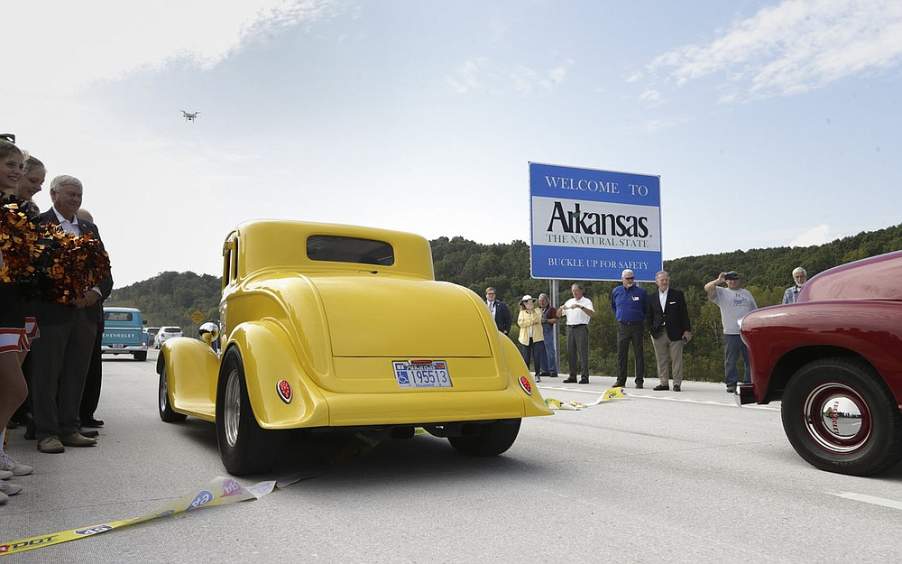 Cars enter the new Interstate 49 Bella Vista Bypass, Thursday, September 30, 2021 near Hiwasse. Arkansas Gov. Asa Hutchinson and Missouri Gov. Mike Parson joined highway officials from both states, highway commissioners, legislators and members of the public at the Arkansas-Missouri border to celebrate with a ribbon cutting. The newly constructed highway will open to the public Friday. Check out nwaonline.com/211001Daily/ for today's photo gallery.  (NWA Democrat-Gazette/Charlie Kaijo)