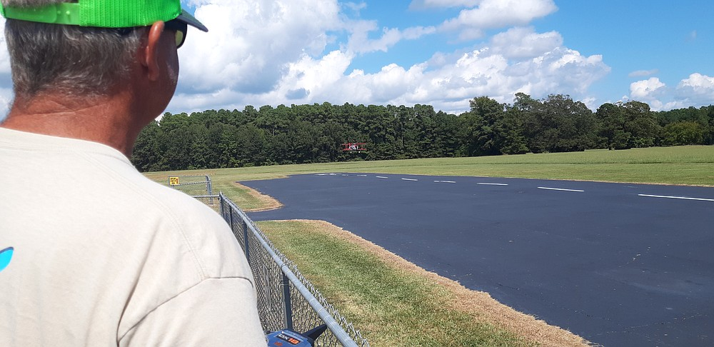 Greg Skinner of Oscar, Oklahoma, flies his Mamba 120, produced by Flex Innovations, during the 2021 Texarkana Radio Control Flying Club Fly-In at Ravel Stroman Field, Wright Patman Lake. The event brings flyers from across the region to meet others who love the hobby. (Staff photo by Junius Stone)