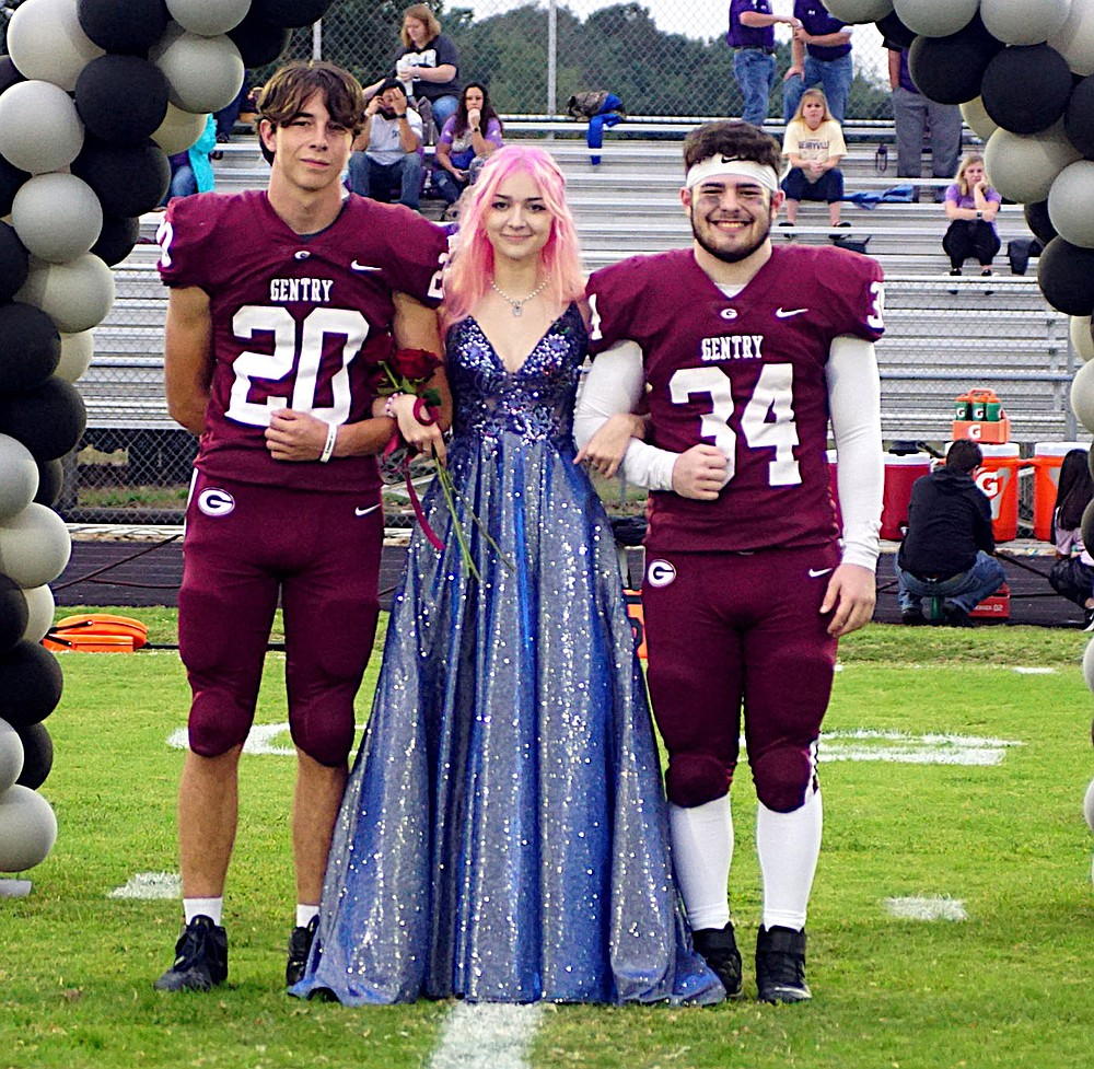 Westside Eagle Observer/RANDY MOLL Gentry senior Berlin Beck was escorted by seniors Ethan Evans and William Pyburn.