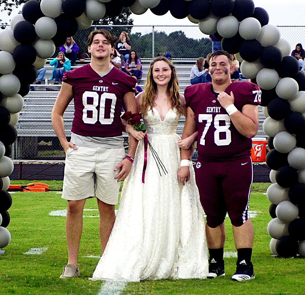 Westside Eagle Observer/RANDY MOLL Gentry senior Ambry Smith was escorted by seniors Garrison Jackson and Aiden Whitehead.
