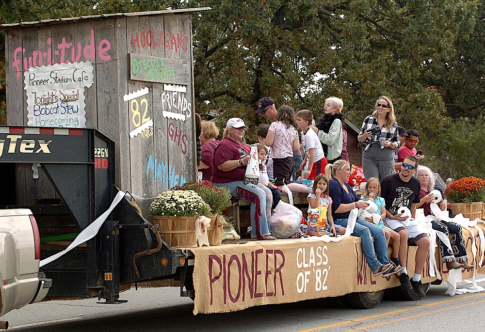 Westside Eagle Observer/RANDY MOLL The Class of 1982 again had a float in this year's homecoming parade and spread a little TP along the parade route.