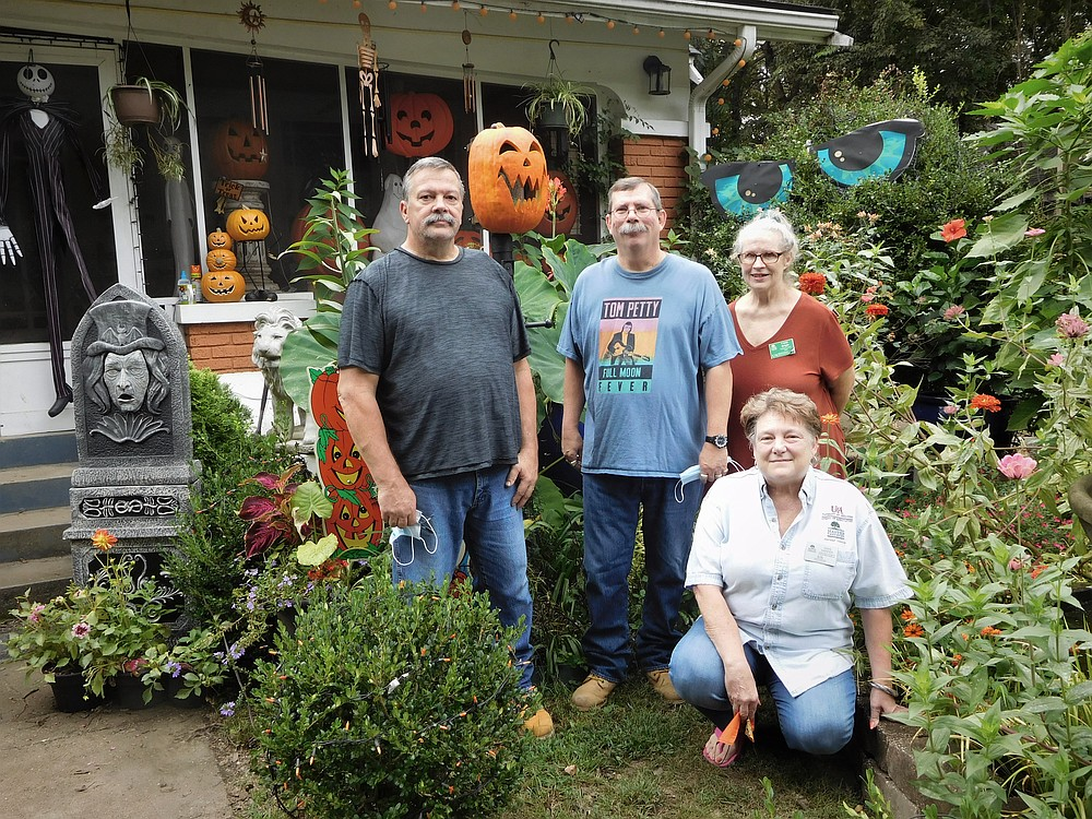 From left are homeowners Derrille Warner and Tony Gordon and Master Gardeners Cindy Bright and Gaye Harper. Not pictured are Master Gardeners Carolyn Davis and Jennetta Sanders. - Submitted photo